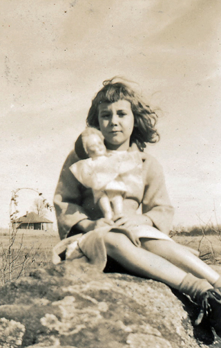 Deloris McRae, with doll